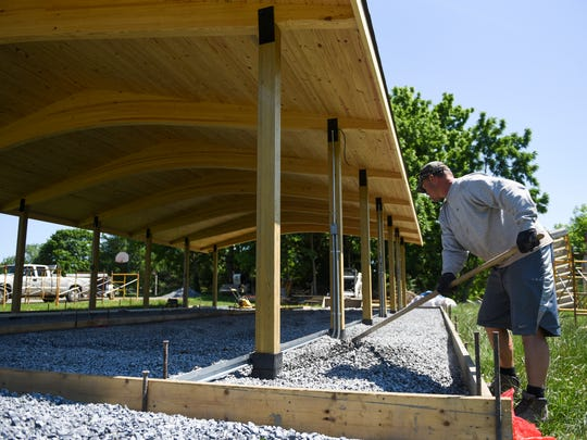 Jesse Brown, of J.B. Concrete, prepares the new pavilion at the Church of the Good Shepherd in North Cornwall Township for concrete on Thursday, June 9, 2016.