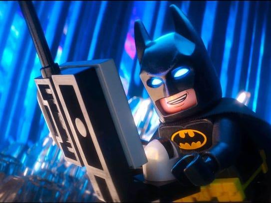 Watch Batman on a 32-foot-high inflatable big screen.