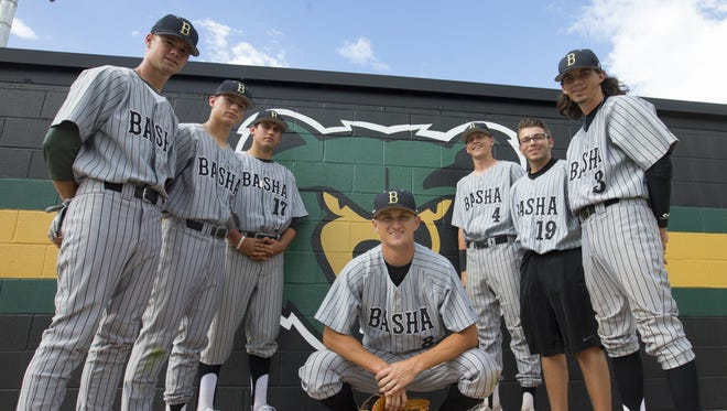 Basha baseball player Ryan Tierney, center,  and his teammates, from left,  Tyler Riddle, Jack Schneider, Johnny Morell, Casey Legumina, Jordan Bentivenga and Corey Stuart  donated used and new baseball equipment to kids that are less fortunate as part of their senior project.