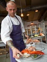 Chef James Avery prepares the raw bar at The Bonney