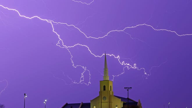 Lightning streaks across the sky behind a church in Montgomery, Ala., on March 18, 2013.  Fewer Americans were killed by lightning in 2013 than in any year on record.
