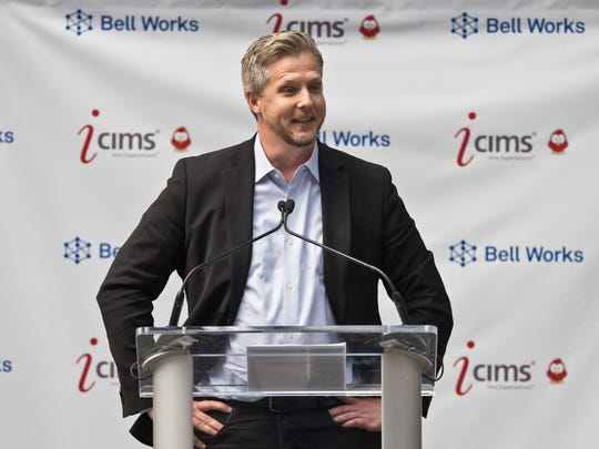 Colin Day, CEO of iCIMS, speaks to the crowd gathered for the occasion. iCIMS, a fast growing technology company, signs a lease to take up 300,000 plus-square-feet of space in the former Bell Works building.  Holmdel, NJ Wednesday, July 20, 2016@dhoodhood