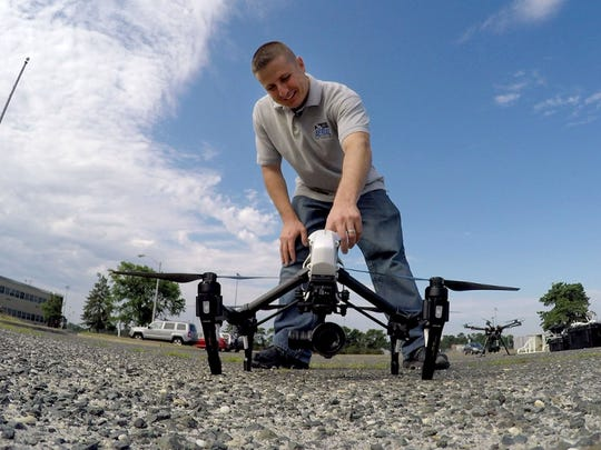 James Kosma, the owner of Shore Arieal Photography, prepares to launch his DJI Inspire drone in the parking lot at the Emma Havens Young Elementary School in Brick Township Wednesday, July 12, 2017.