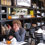 In this Oct. 19, 2011 photo, rock star Jon Bon Jovi sits in his JBJ Soul Kitchen community restaurant in Red Bank, N.J. which lets the needy do community service in return for a hot meal. On Feb. 24, 2015 Bon Jovi said his charitable foundation is funding a similar community restaurant at a firehouse in Union Beach, N.J., which is struggling to recover from Superstorm Sandy nearly 2 1/2 years later. (AP Photo/Wayne Parry)