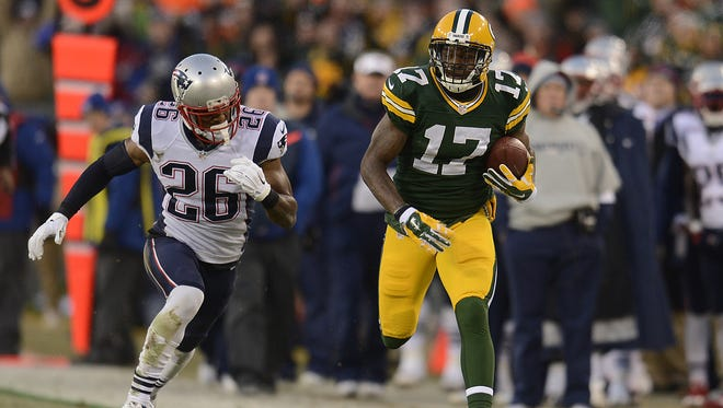 Green Bay Packers receiver Davante Adams runs away from New England Patriots cornerback Logan Ryan after making a catch at Lambeau Field last November.