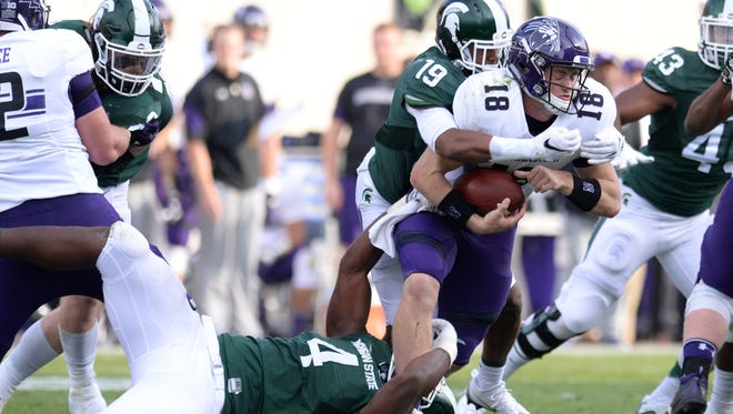 Junior defensive lineman Malik McDowell (4) and redshirt freshman cornerback Josh Butler (19) sack Northwestern quarterback Clayton Thorson early in Saturday's game. It was the Spartans' only sack, though they did get pressure on Thorson semi-regularly.