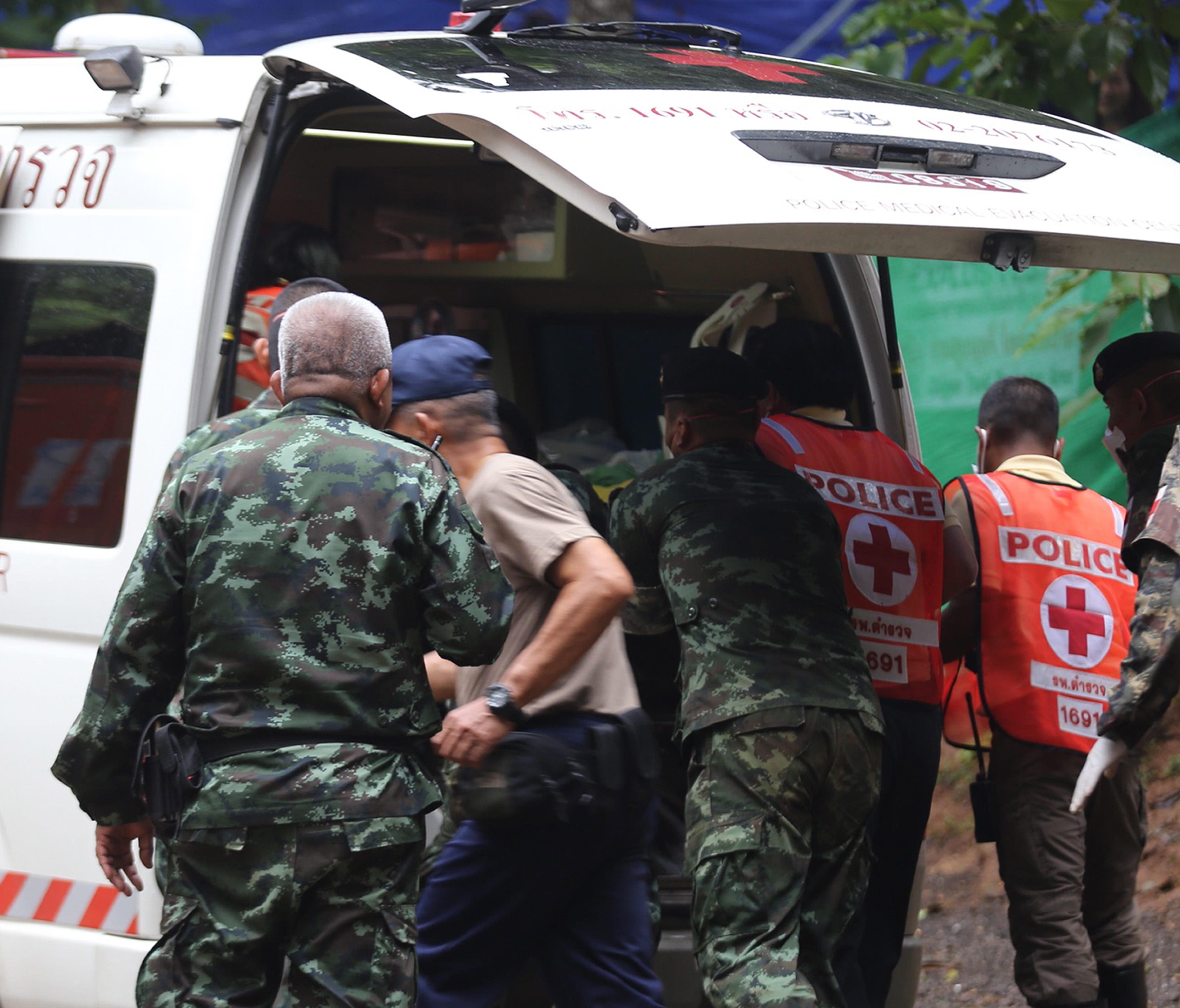 A handout photo made available by the Chiang Rai Public Relations Office shows Thai authorities placing a rescued boy in an ambulance for transportation from Tham Luang cave to a hospital, in Khun Nam Nang Non Forest Park, Chiang Rai province, Thaila