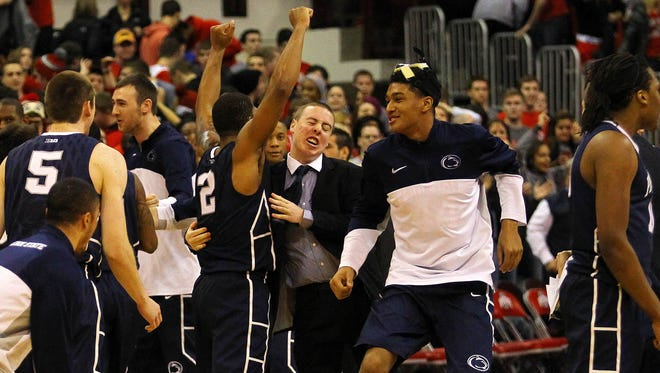 The Penn State Nittany Lions celebrate on the floor after defeating the Ohio State Buckeyes 71-70 in overtime at Schottenstein Center.