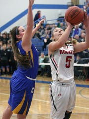 Oak Harbor's Maddy Rathbun puts up a shot against Clyde's Jackie Smith.