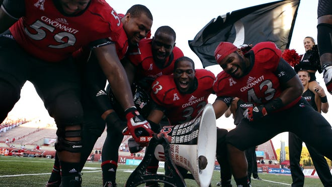 The Bearcats ring the Victory Bell after last year's win against MU.