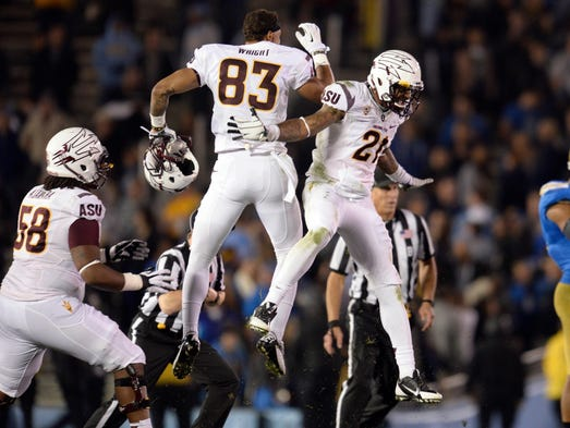 Arizona State Sun Devils wide receiver Alante Wright (83) and Arizona State Sun Devils wide receiver Jaelen Strong (21) celebrate as time runs out in the Sun Devils win over the UCLA Bruins at Rose Bowl.
