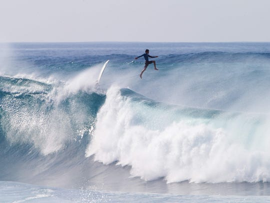New York surfer Balaram Stack wipes out, Friday, during