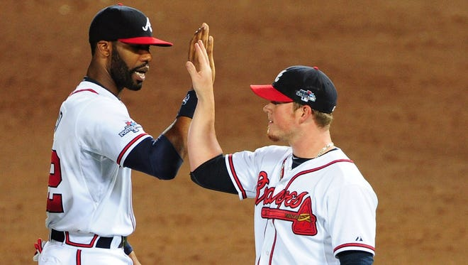 Jason Heyward (left) and Craig Kimbrel of the Atlanta Braves celebrate after defeating the Los Angeles Dodgers during Game Two of the National League Division Series at Turner Field on Oct. 4 in Atlanta.