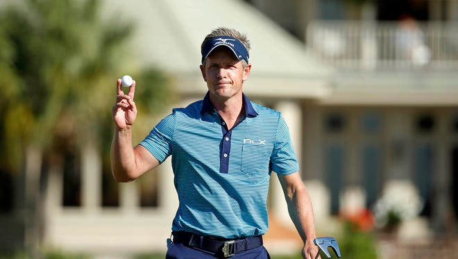 Luke Donald celebrates his par putt on the 17th hole during the third round of the RBC Heritage at Harbour Town Golf Links on April 16, 2016.
