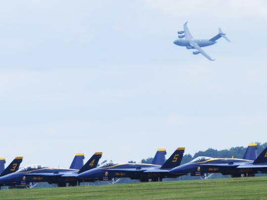 A C17 Globe Master III flies above Navy Blue Angel