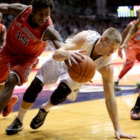 Butler's Austin Etherington dribbles away from St. John's Sir'Dominic Pointer in the second half of the Bulldogs, 85-62 win over the Red Storm on Feb. 3, 2015 at Hinkle Fieldhouse.