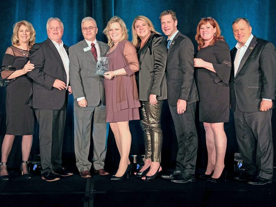 EXIT Awards Banquet (l-r) Janice Petteway, director of Brokerage Development EXIT Realty Corporation International; Kenny Lynn, regional owner of EXIT Southeast; Rick DeBusk, owner/principal broker EXIT Realty Music Row; Amy DeBusk, owner EXIT Realty Music Row; Stacy Strobl, regional owner EXIT Southeast; Craig Witt, president, US Division EXIT Realty Corporation International; Tami Bonnell, CEO, EXIT Realty Corporation International; Steve Morris, founder/chairman EXIT Realty Corporation International.