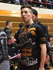 Northmor senior Aaron Kitts wears the pin chain, complete