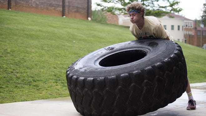Noah Gminski works out with a tire during a Christ School track practice April 27.