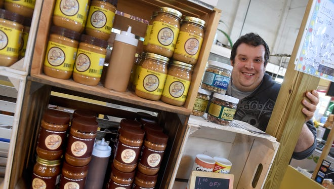 Albert Trevaskis, owner of Goin' Nuts peanut butter stand at Central Market.
