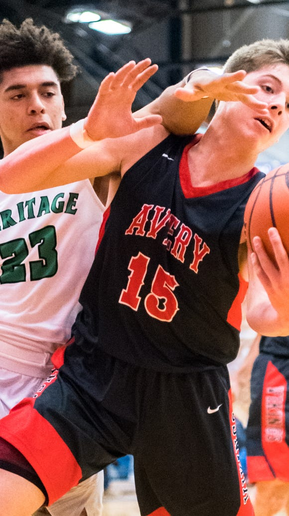 The Mountain Heritage boys basketball team played Avery