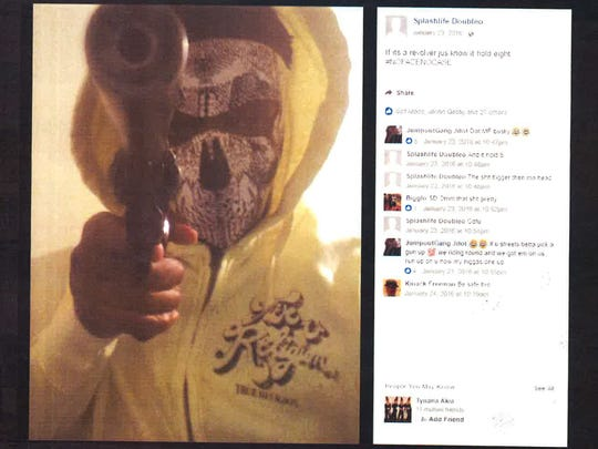 Sha'Mir Sudler poses with a gun and a mask over his face, according to state prosecutors who entered this Facebook photo into evidence.