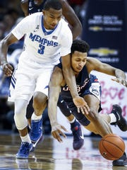 Memphis guard Jeremiah Martin (left) and UConn's Jalen Adams (right) are two of the AAC's top three leading scorers this year.