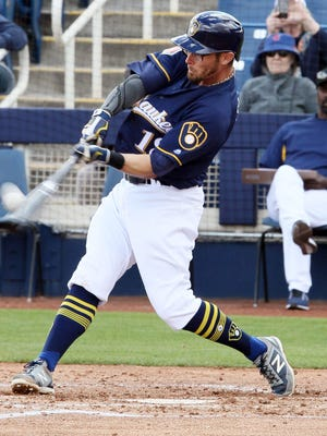 Eric Sogard laces a two-run triple to put the Brewers ahead to stay in the teams' Cactus League opener on Friday at the Maryvale Baseball Park in Phoenix.