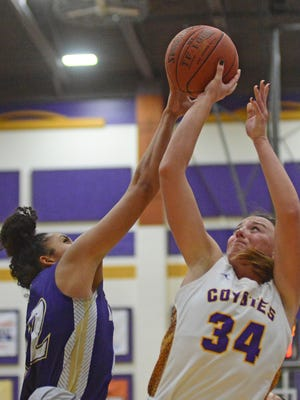 Kansas Wesleyan's Amanda Hill (34) gets her shot blocked by Bellevue's Elexis Martinez during the third period of the non-conference game in Mabee Arena on Tuesday night.