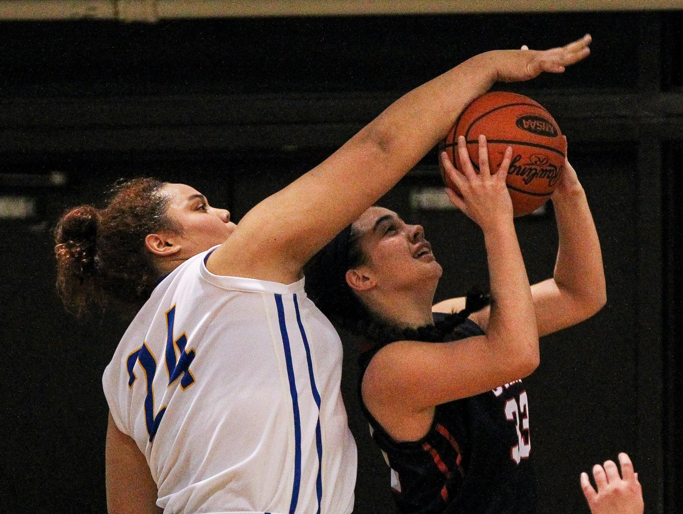 NewCath's Ajia Rice blocks a shot by Dixie's Brooke Davis during the first quarter.