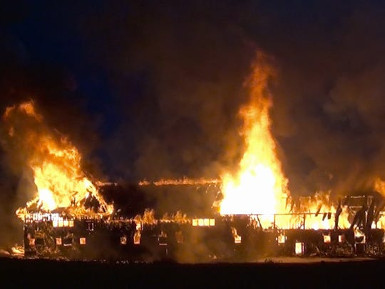 The Old Dairy Barn at Shelburne Farms is consumed by flames early Sunday morning. Fire crews arrived to find the structure fully involved after they received reports of smoke and flames seen in the area.