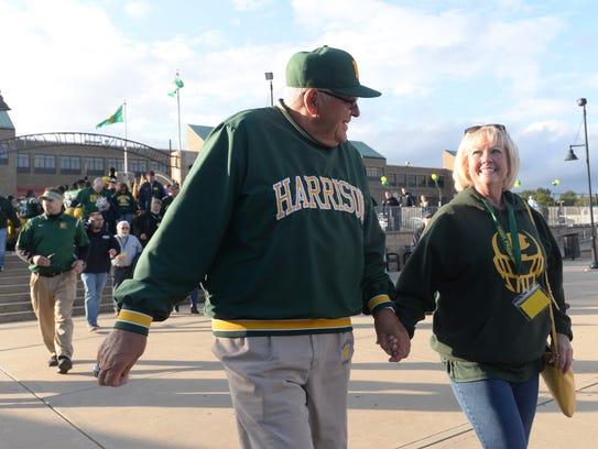 Harrison head football coach walks into the officially