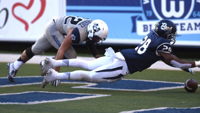 Nevada's Elijah Mitchell recovers a fumble in the end zone for a touchdown.
