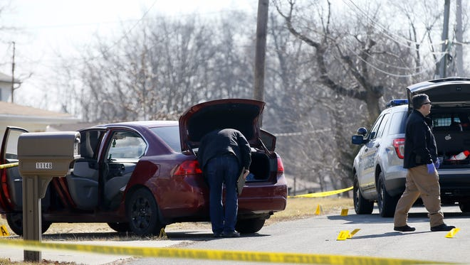 Investigators process the scene of a shooting near the intersection of Oak and Florence avenues in Blue Ash, Sunday, Feb. 7, 2016.