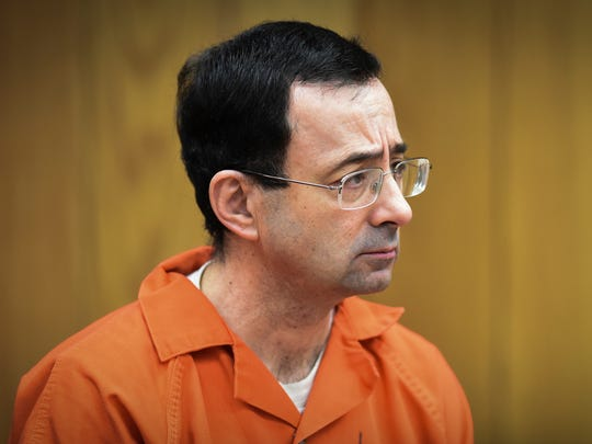 There was little reaction in Larry Nassar's face as he was sentenced Monday, Feb. 5, 2018, in Judge Janice Cunningham's Eaton County Court in Charlotte, Mich., where Nassar was sentenced to 40-125 years in prison on three counts of sexual assault.