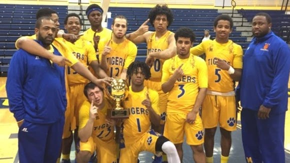 Martin Luther King is pictured with the gold ball. The Tigers beat Clark Academy 76-60 to win the Section 1 Class D boys basketball championship at Pace University on Feb. 23, 2018.