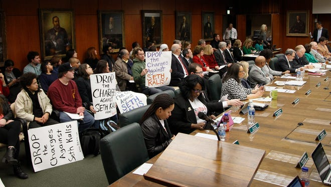 About 20 students, some wielding signs attended the Michigan State University Board of Trustees meeting Feb. 17, 2017, to speak out against trustee Mitch Lyons' tweets related to the immigration executive order, others talked about the university's response to allegations against Larry Nassar and three MSU football players.