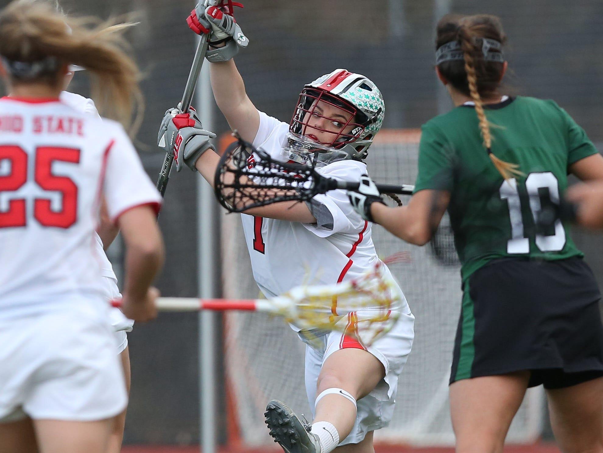 Ohio State goalie Katie Frederick (1) blocks a shot during game against Binghamton at Yorktown High School March 25, 2016. Ohio State won the game 10-5. Frederick is a graduate of Yorktown High School.
