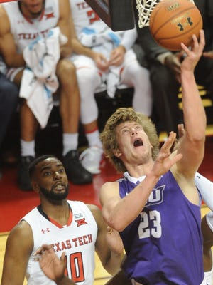ACU's Hayden Howell (23) shoots as Texas Tech's Niem Stevenson (10) looks on. The No. 21 Red Raiders beat ACU 74-47 in the nonconference men's basketball game Friday, Dec. 22, 2017 in Lubbock.