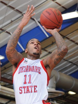 Delaware State University's DeAndre Haywood, seen here against Radford, scored career point 1,000 as the Hornets defeated Bethune-Cookman in overtime on Saturday.