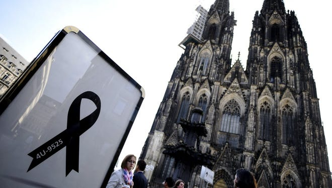 A black ribbon showing the flight number of Germanwings flight 4U9525 is displayed at the Dom cathedral, ahead of a memorial service to commemorate the victims of the Germanwings passenger plane crash. Photo is from April 17, in Cologne, Germany.