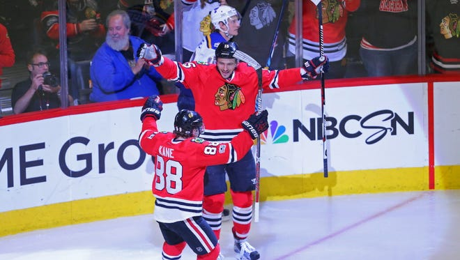 Chicago Blackhawks forward Artem Anisimov (15) celebrates scoring a goal with right wing Patrick Kane (88) during the third period against the St. Louis Blues.