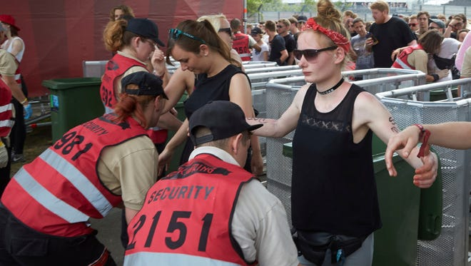 Visitors are searched at the music festival Rock am Ring in Nuerburg, Germany, on June 3. German authorities allowed the popular rock festival to go ahead after a scare over people with suspected links to Islamic extremism prompted them to curtail its opening night.