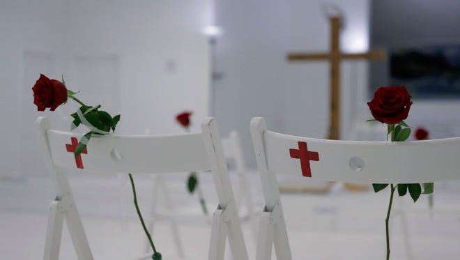 A memorial at the First Baptist Church in Sutherland Springs, Texas, on Nov. 12, 2017, includes 26 white chairs.