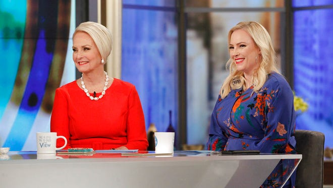 "This image released by ABC shows Cindy McCain appearing with her daughter, co-host Meghan McCain, during a broadcast for ""The View,"" on Feb. 28, 2018, in New York."