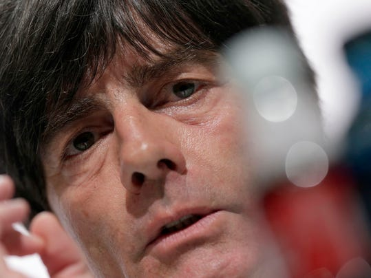 German national soccer team head coach Joachim Loew gestures during a news conference in Santo Andre near Porto Seguro, Brazil, Saturday, June 28, 2014. Germany will face Algeria in their round of 16 match of the 2014 soccer World Cup in Porto Alegro on Monday. (AP Photo/Matthias Schrader)