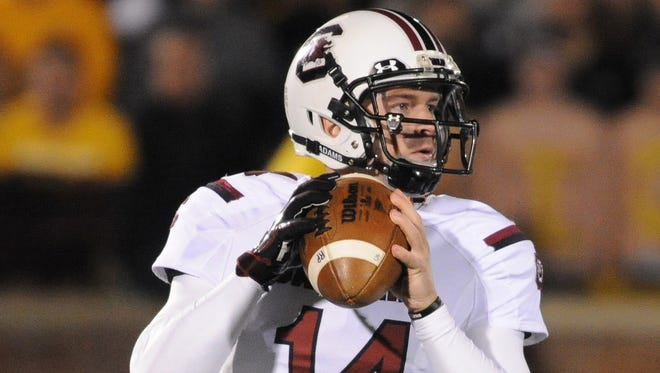 South Carolina quarterback Connor Shaw (14) looks downfield during the fourth quarter Saturday against the Missouri Tigers at Faurot Field. South Carolina won 27-24 as Shaw rallied his team from a 17-0 second-half deficit.