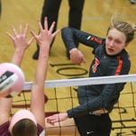 Valley junior Hannah Lockin hits the ball over the net past the reach of Dowling Catholic defenders during a match at Dowling on Sept. 29.