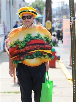 Robert Haines, of Virginville, Pa., wears hamburger attire during the 12th annual Taste of Hamburg-er Festival in Hamburg, Pa., on Saturday, Sept. 5, 2015.