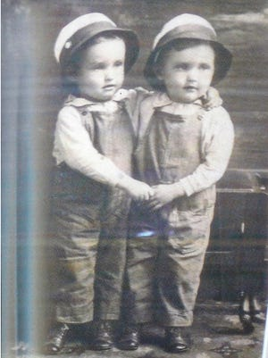 Cleo and Clifford Hawthorne of Iowa are shown in toddler photos, but relatives don't know which one is which.